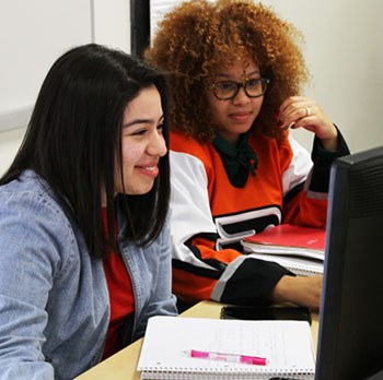 Two female students working at computers