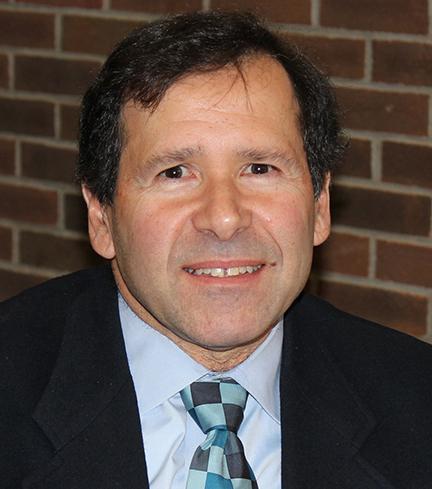 Dr. Louis T. Manzione