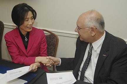 Dr. Jianping Wang and FDU President Sheldon Drucker